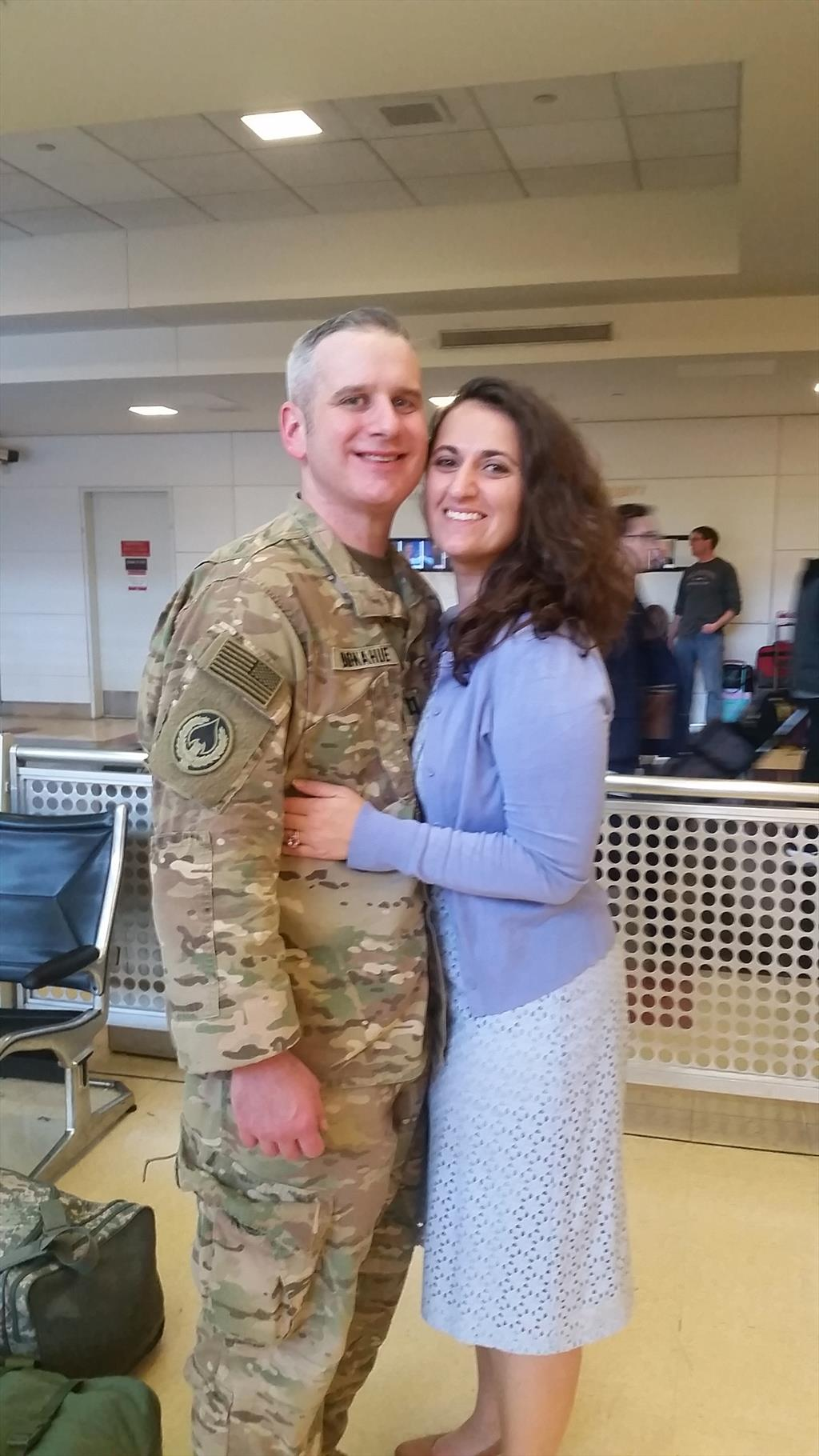 CPT Donahue pictured with his wife Ashley Ludovicy-Donahue (Class of '09) at the airport upon his return home.